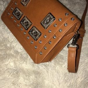 Brown purse with silver accents